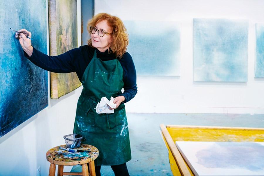 Virginia Bradley painting in studio